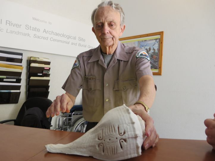 Park Volunteer showing off carved shell